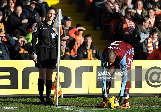 Assistant Referee Sian Massey looks on as Ashley Young of Aston Villa places the ball down for a corner kick during the Barclays Premier League match...