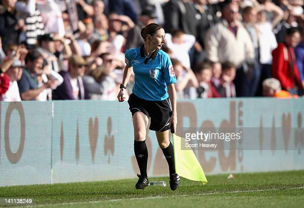 Assistant referee Sian Massey runs along the line during the Barclays Premier League match between Swansea City and Manchester City at the Liberty...
