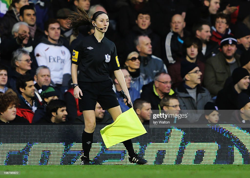 Assistant referee <a gi-track='captionPersonalityLinkClicked' href=/galleries/search?phrase=Sian+Massey&family=editorial&specificpeople=6733765 ng-click='$event.stopPropagation()'>Sian Massey</a> runs the line during the Barclays Premier League match between Fulham and Swansea City at Craven Cottage on December 29, 2012 in London, England.