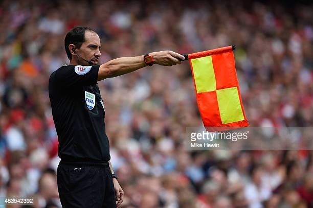 Assistant referee Stephen Child flags offside during the Barclays Premier League match between Arsenal and West Ham United at Emirates Stadium on...