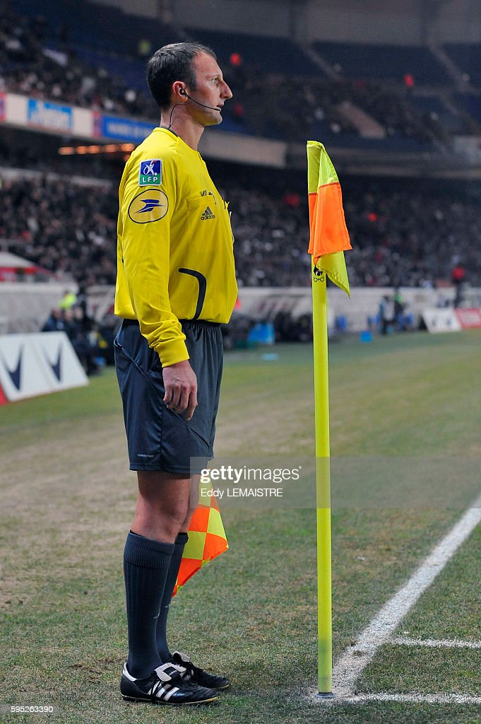Assistant referee with his flag