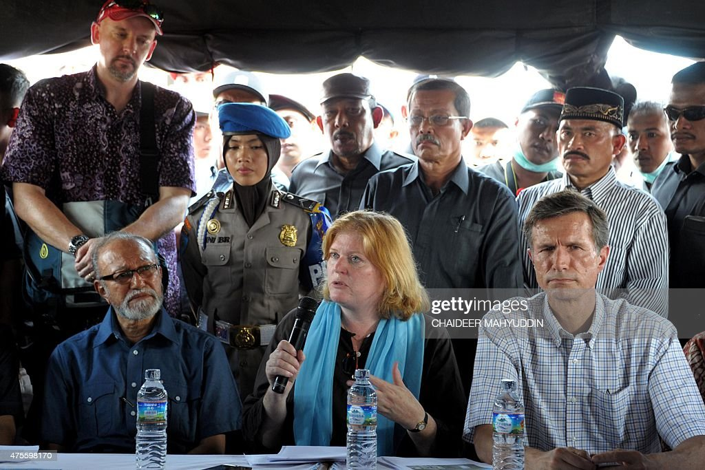 US Assistant Secretary of State Anne Richard is accompanied by Aceh culture director Malik Mahmud and US Ambassador Robert Blake as she delivers her...