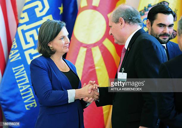 US Assistant Secretary of State for European and Eurasian Affairs Victoria Nuland shakes hands with Serbia's Foreign Minister Ivan Mrkic before they...