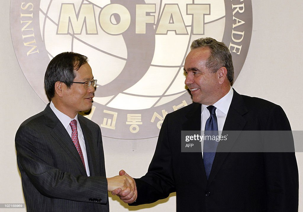 US assistant secretary of state Kurt Campbell (R) shakes hands with South Korean Vice Foreign Minister Chun Young-woo during their meeting at the Foreign Ministryin Seoul on June 17, 2010. Campbell met with South Korean officials to discuss strategies to censure North Korea at the United Nations for the deadly sinking of a South Korean warship.