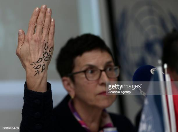 Assistant SecretaryGeneral for Humanitarian Affairs and Deputy Emergency Relief Coordinator Ursula Mueller shows her henna tattoo done by a Syrian...