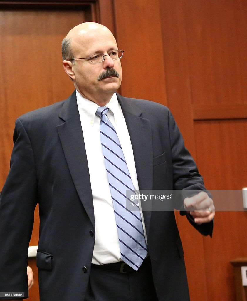 Assistant state attorney Bernie de la Rionda attends a status hearing in the Trayvon Martin case, in Seminole circuit court March 5, 2013 in Sanford, Florida. The defense lawyers were reportedly looking for more access to the FBI's investigation into possible civil rights violations in the shooting of Martin.