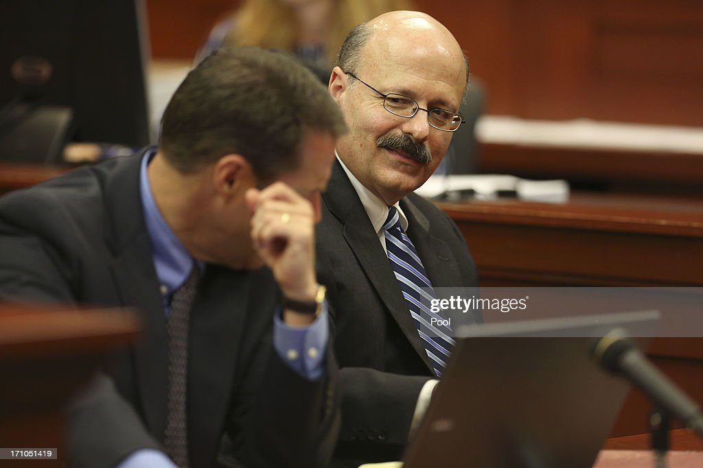 Assistant state attorney Bernie de la Rionda looks over at his co-counsel John Guy during George Zimmerman's trial in Seminole circuit court June 21, 2013 in Sanford, Florida. Zimmerman is charged with second-degree murder for the February 2012 shooting death of 17-year-old Trayvon Martin.
