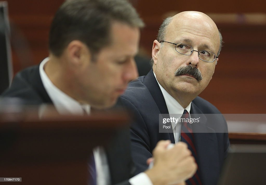 Assistant state attorney Bernie de la Rionda looks up at the defense during jury selection in George Zimmerman's trial in Seminole circuit courtJune 20, 2013 in Sanford, Florida. Zimmerman is charged with second-degree murder for the February 2012 shooting death of 17-year-old Trayvon Martin.