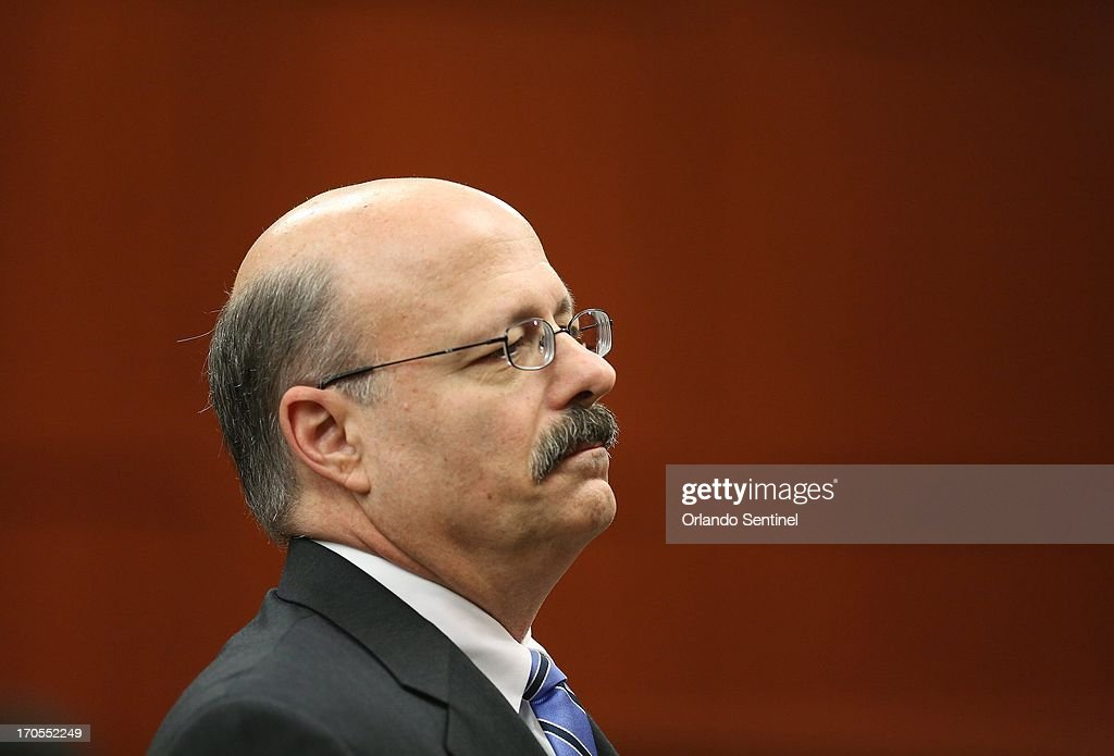 Assistant State Attorney Bernie de la Rionda stands as a group of potential jurors enter the courtroom on the fifth day of jury selection during George Zimmerman's trial in Seminole circuit court in Sanford, Florida, Friday, June 14, 2013. Zimmerman has been charged with second-degree murder for the 2012 shooting death of Trayvon Martin.