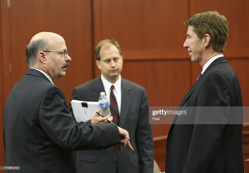 Assistant state attorney Bernie de la Rionda (L) taks to lead defense attorney Mark O'Mara during George Zimmerman's trial in Seminole circuit court June 21, 2013 in Sanford, Florida. Zimmerman is charged with second-degree murder for the February 2012 shooting death of 17-year-old Trayvon Martin.