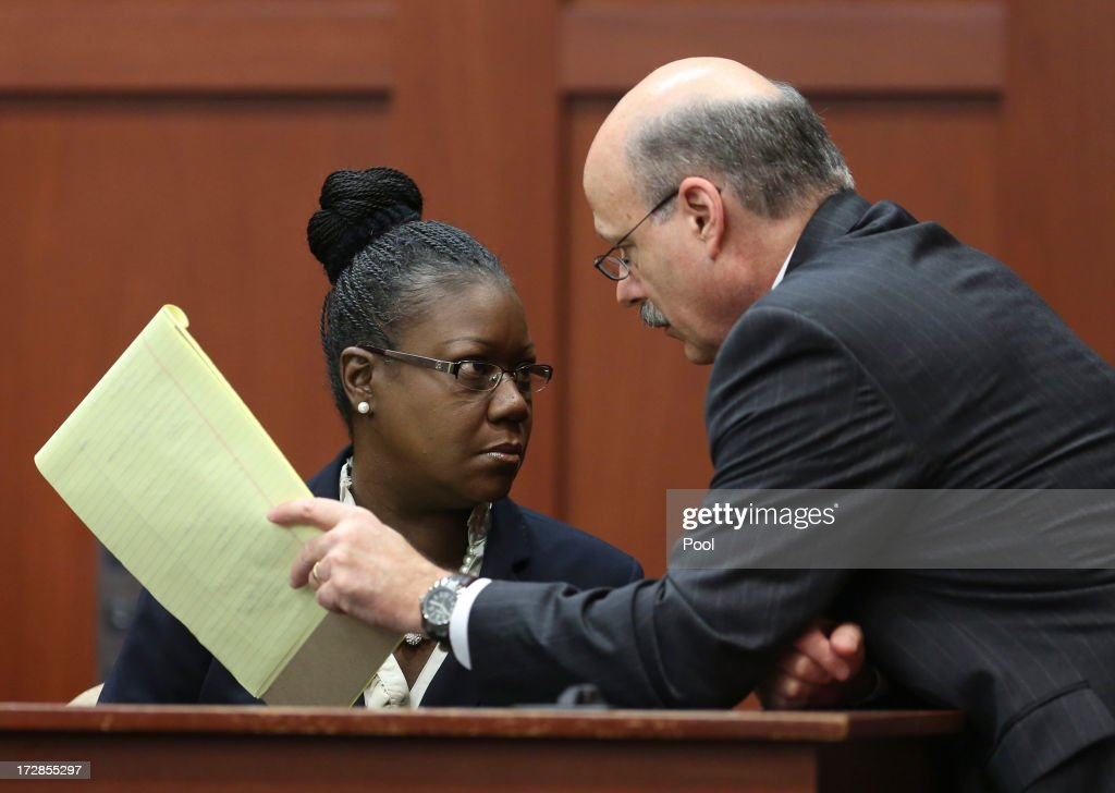 Assistant state attorney Bernie de la Rionda talks to Sybrina Fulton, Trayvon Martin's mother, on the stand during a recess in George Zimmerman's trial in Seminole circuit court July 5, 2013 in Sanford, Florida. Zimmerman is charged with second-degree murder for the February 2012 shooting death of 17-year-old Trayvon Martin.