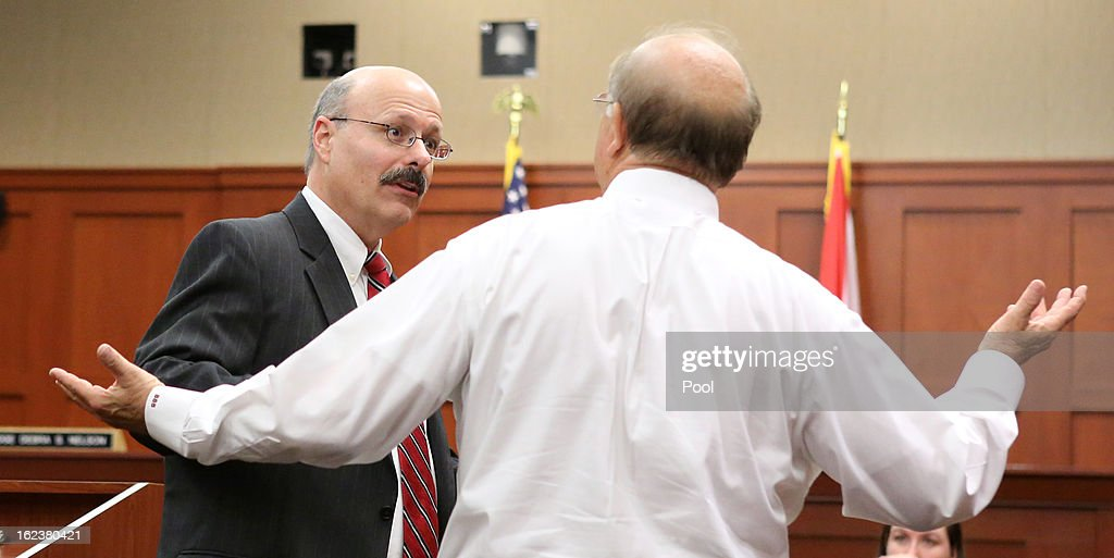 Assistant State Attorney Bernie de la Rionda (L) talks with attorney Bruce Blackwell, counsel for the attorney representing the attorney of the Trayvon Martin's parents, before the start of the hearing in the George Zimmerman case in Seminole circuit court February 22, 2013 in Sanford, Florida. efense attorneys for Zimmerman , who is accused of the murder of Trayvon Martin, were asking to depose Benjamin Crump, a lawyer for Trayvon Martin's parents, about an interview. The judge ruled against that request, but ruled in favor of a defense request for all voice recordings from the past three years that Trayvon Martin's parents and girlfriend have.