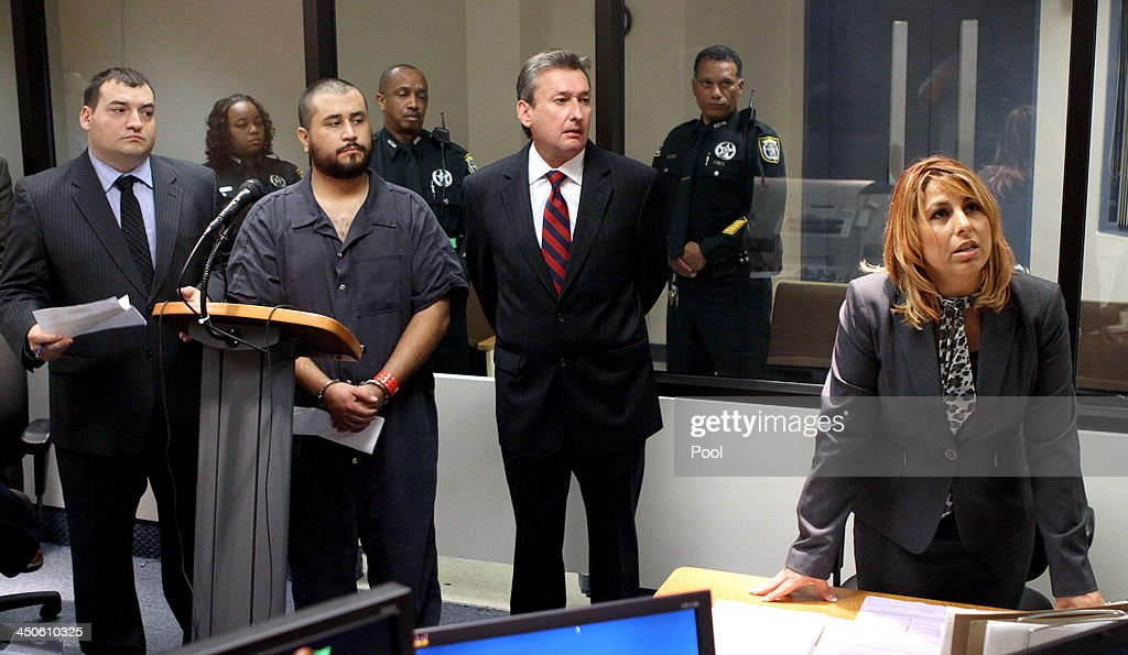 Assistant State Attorney Lymary Munoz (R) argues for a high bail amount for <a gi-track='captionPersonalityLinkClicked' href=/galleries/search?phrase=George+Zimmerman&family=editorial&specificpeople=9042868 ng-click='$event.stopPropagation()'>George Zimmerman</a> (2L), the acquitted shooter in the death of Trayvon Martin as he stands with his defense counsel Daniel Megaro (left) and Jeff Dowdy during a first-appearance hearing on charges including aggravated assault stemming from a fight with his girlfriend November 19, 2013 in Sanford, Florida. Zimmerman, 30, was arrested after police responded to a domestic disturbance call at a house. He was acquitted in July of all charges in the shooting death of unarmed, black teenager, Trayvon Martin.