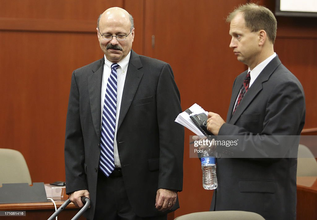 Assistant state attorneys Bernie de la Rionda, and Richard Matei leave the courtroom after addressing a series of pre-trail issues with Judge Debra Nelson during George Zimmerman's trial in Seminole circuit court June 21, 2013 in Sanford, Florida. Zimmerman is charged with second-degree murder for the February 2012 shooting death of 17-year-old Trayvon Martin.