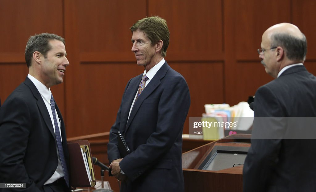 Assistant state attorneys John Guy (L), and Bernie de la Rionda (R), talk with defense attorney Mark O'Mara, at the end of the day during George Zimmerman's trial in Seminole circuit court July 12, 2013 in Sanford, Florida. Judge Debra Nelson has ruled that the jury can also consider a lesser manslaughter charge along with the second-degree murder charge in the shooting death of Trayvon Martin.