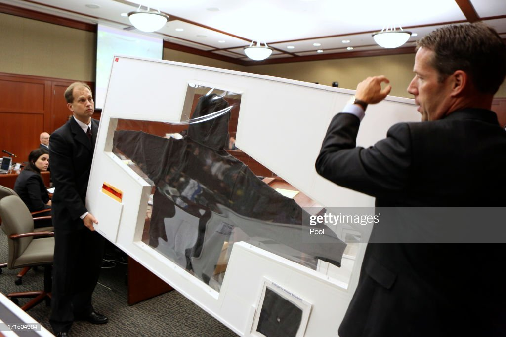 Assistant state attorneys John Guy (R) and Richard Mantei hold up Trayvon Martin's hoodie as evidence during George Zimmerman's trial in Seminole circuit court June 25, 2013 in Sanford, Florida. Zimmerman is charged with second-degree murder for the February 2012 shooting death of 17-year-old Trayvon Martin.