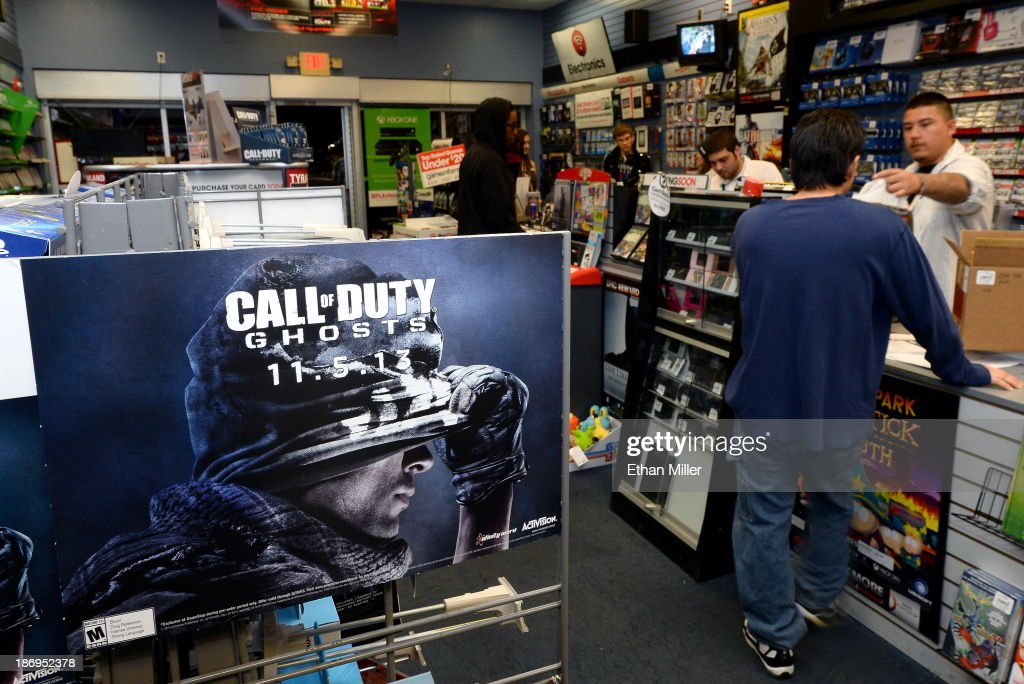 Assistant store manager Paul Camacho (R) sells copies of 'Call of Duty: Ghosts' during a launch event for the highly anticipated video game at a GameStop Corp. store on November 5, 2013 in North Las Vegas, Nevada. Video game publisher Activision released the 10th installment in the 'Call of Duty' franchise at midnight.