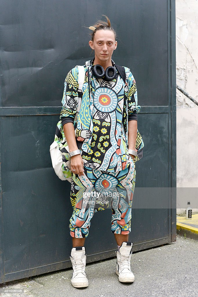 Assistant to Rick Owens Vanya Polunin wearing Rick Owen trainers, Lovesong bag, Parts/Four bracelet and KTZ jacket, top and trousers on day 1 of Paris Collections: Men on June 25, 2014 in Paris, France.