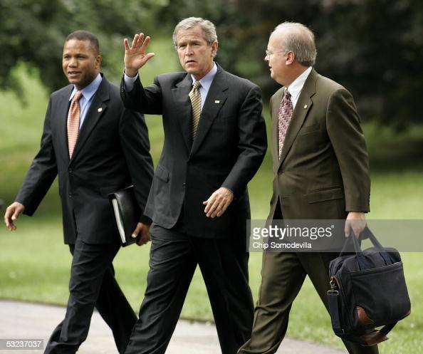Assistant to the President for Domestic Policy Claude Allen Deputy Chief of Staff Karl Rove and US President George W Bush walk from the Oval Office...