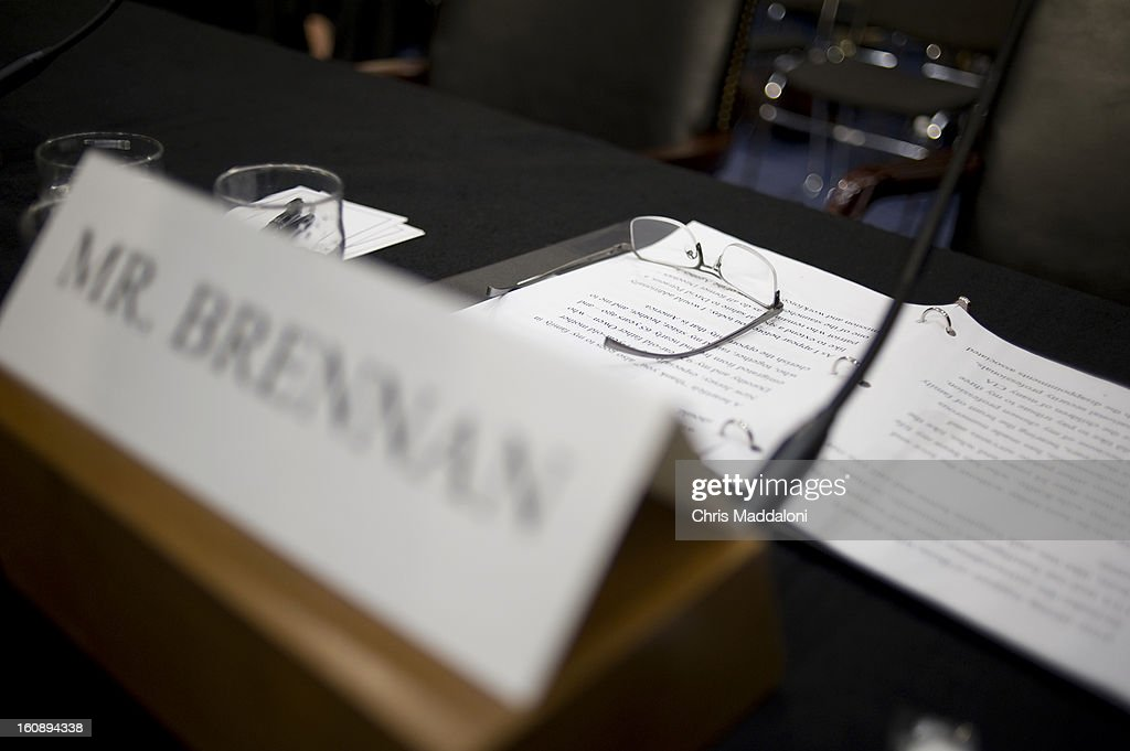 U.S. Assistant to the President for Homeland Security and Counterterrorism John Brennan left his glasses after leaving the Senate Intelligence Committee for his nomination to be the next Director of the Central Intelligence Agency. The room was cleared of the general public after numerous protesters continue to disrupt the hearing. Brennan is expected to face harsh questioning the drone targeted killing program.