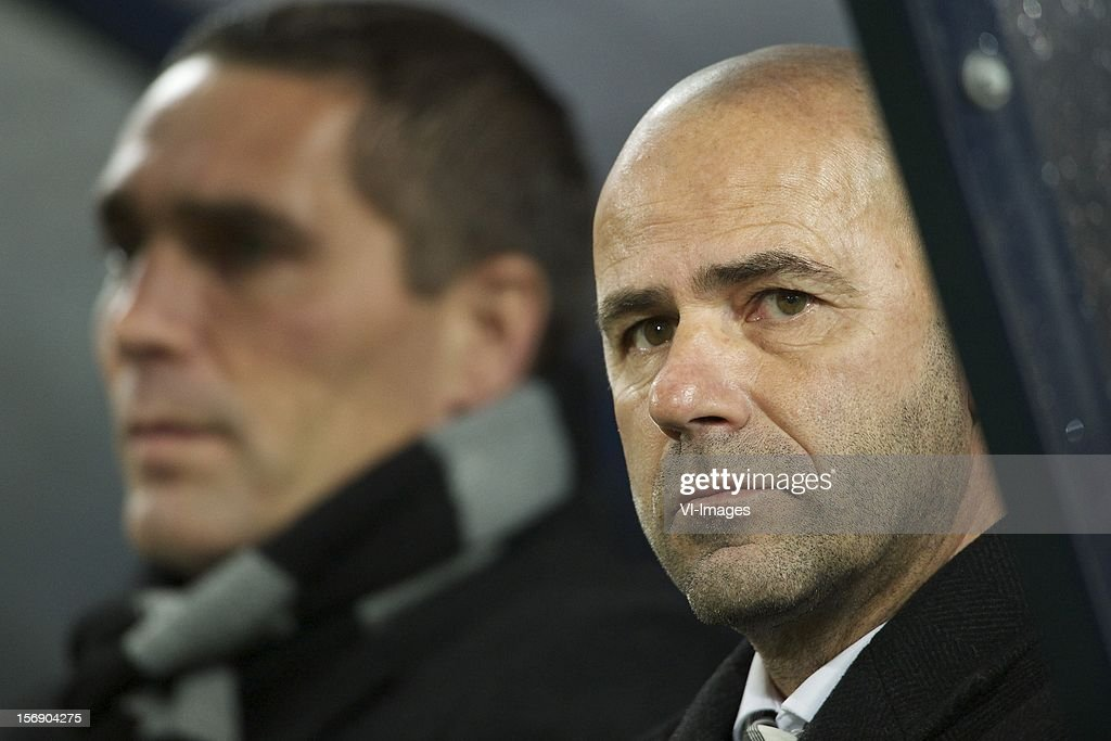 assistant trainer Hendrie Kruzen of Heracles Almelo, coach Peter Bosz of Heracles Almelo during the Dutch Eredivisie match between Willem II and Heracles Almelo at the Koning Willem II Stadium on November 24, 2012 in Tilburg, The Netherlands.