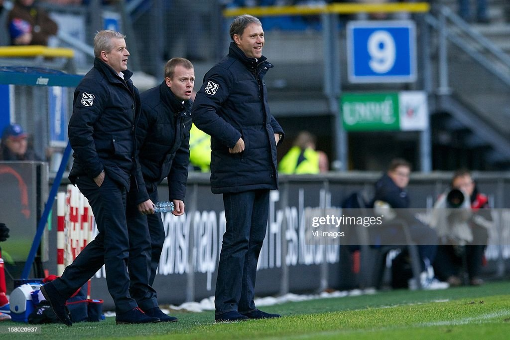 assistant trainer Henk Herder of SC Heerenveen, assistant trainer Thieme Klompe, coach Marco van Basten of SC Heerenveen during the Dutch Eredivisie match between SC Heerenveen and Roda JC Kerkrade at the Abe Lenstra Stadium on December 09, 2012 in Heerenveen, The Netherlands.