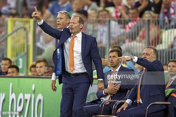 assistant trainer Marco van Basten of Holland coach Danny Blind of Holland assistant trainer Ruud van Nistelrooij of Holland assistant trainer Dick...