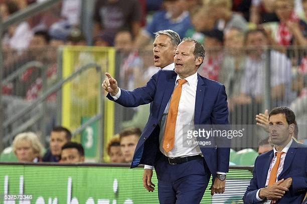 assistant trainer Marco van Basten of Holland coach Danny Blind of Holland assistant trainer Ruud van Nistelrooij of Holland during the International...