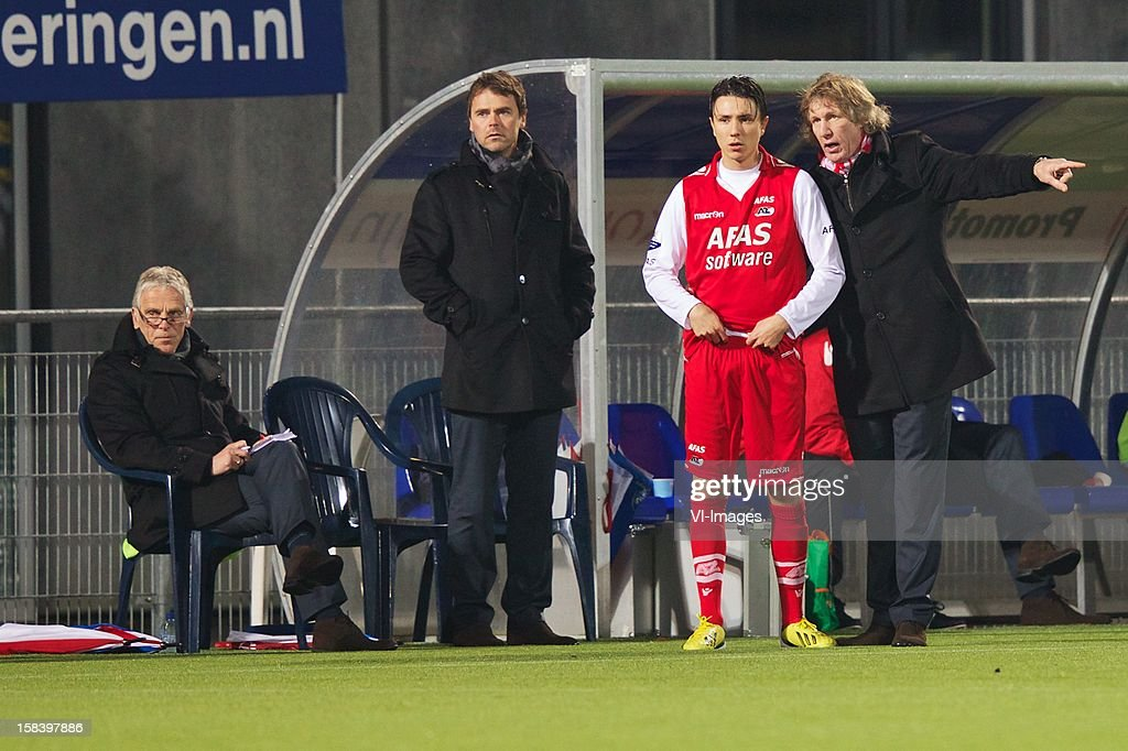 assistant trainer Martin Haar of AZ, assistant trainer Dennis Haar of AZ, Steven Berghuis of AZ, coach Gert Jan Verbeek of AZ during the Dutch Eredivisie match between PEC Zwolle and AZ Alkmaar at the IJsseldelta Stadium on December 15, 2012 in Zwolle, The Netherlands.