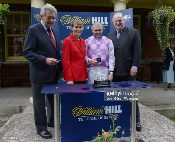 Assistant trainer to Richard Fahey Mr Robin O'Ryan jockey Tony Hamilton and Mr James Henderson from William Hill following the William Hill Great St...