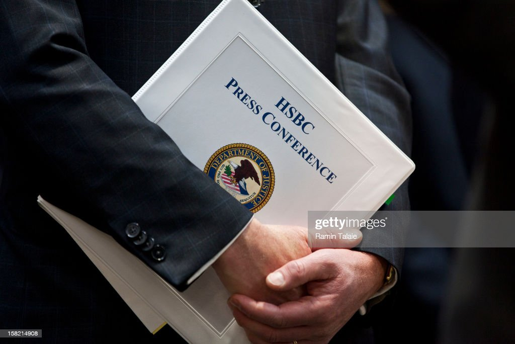 Assistant US Attorney General Lanny Breuer holds a press briefing binder during a news conference in Brooklyn on December 11, 2012 in New York City. HSBC Holdings plc and HSBC USA NA have agreed to forfeit $1.256 billion and enter into a deferred prosecution agreement with the U.S. Department of Justice.