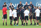 Assistantcoach of PSG Zoumana Camara introduces every PSG player to new coach of Paris SaintGermain Unai Emery before the first training session of...