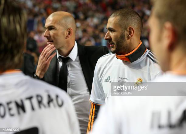 Assistantcoach of Real Madrid Zinedine Zidane and Karim Benzema of Real Madrid celebrate victory in the UEFA Champions League final between Real...