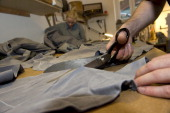 Assistants Daniel Yuhart and Lilika SchulterOstermann cut through used clothes at German fashion designer Daniel Kroh's workshop and showroom in...