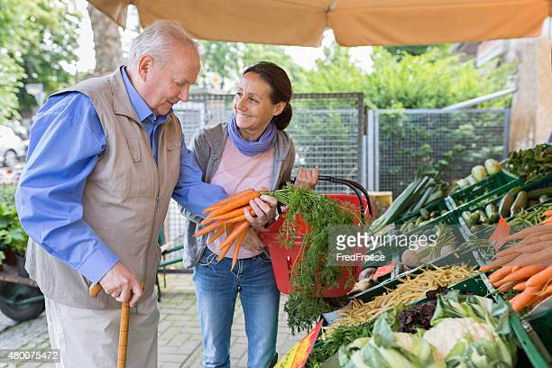 Assisted living - senior man with caregiver shopping