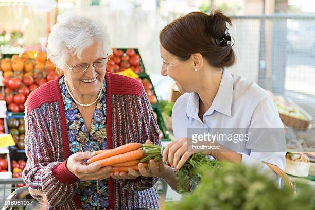 Assisted living - senior woman with caregiver shopping