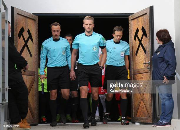 Assistent Bastian Boerner Referee Sven Waschitzki and assistent Mark Borsch come to the pitch during the Second Bundesliga match between FC...