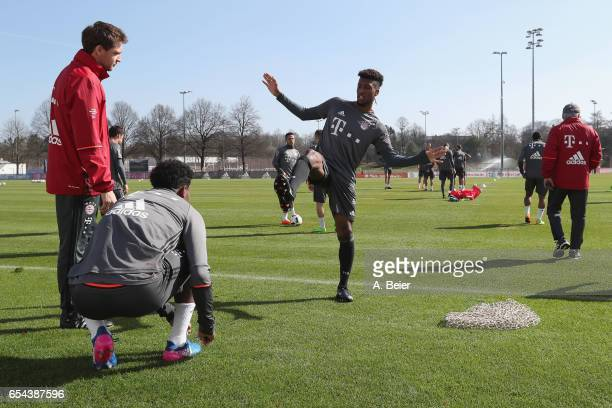 Assistent coach Francesco Mauri talks to David Alaba and Kingsley Coman of FC Bayern Muenchen before a training session at the club's Saebener...