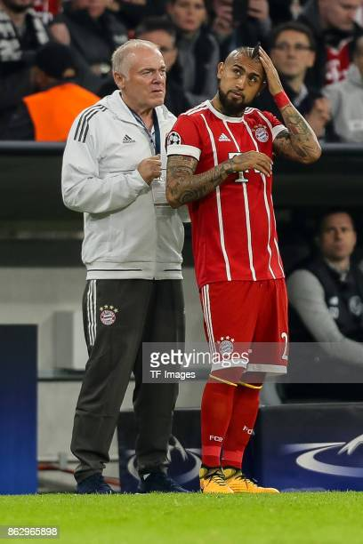 Assistent coach Hermann Gerland of Bayern Muenchen and Arturo Erasmo Vidal of Bayern Muenchen looks on during the UEFA Champions League group B match...