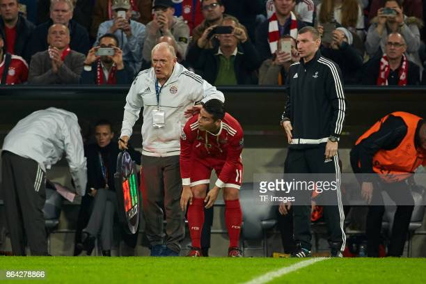Assistent coach Hermann Gerland of Bayern Muenchen James Rodriguez of Bayern Muenchen and Referee Maksim Gavrilin looks on during the UEFA Champions...