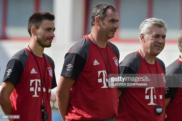 Assistent coaches Davide Ancelotti and Paul Clement pose with new head coach Carlo Ancelotti during the first training session with new Bayern...