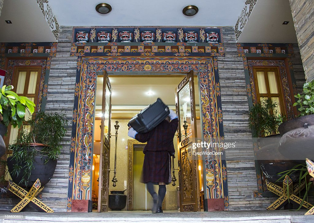 Assistent worker carrying baggage at the Namgay Heritage Hotel on November 18, 2012 in Thimphu, Bhutan.