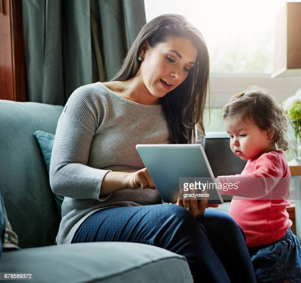 Assisting her child's learning through technology