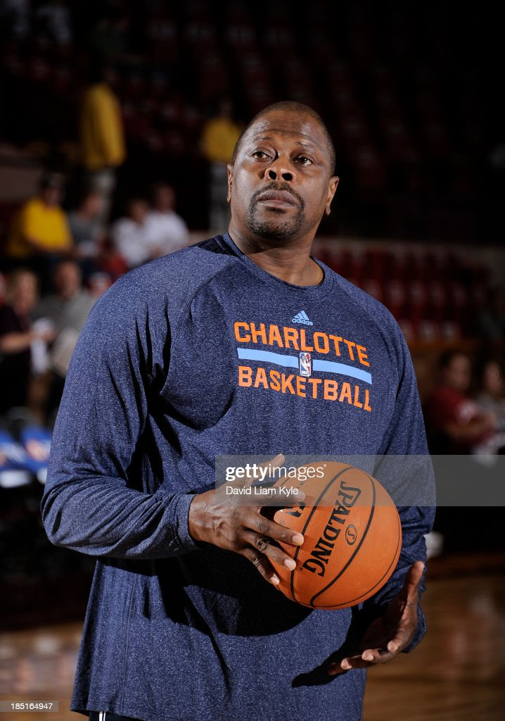 Assistnat head coach Patrick Ewing of the Charlotte Bobcats handles the ball during warm ups prior to the game against the Cleveland Cavaliers at the Canton Memorial Civic Center on October 15, 2013 in Canton, Ohio.