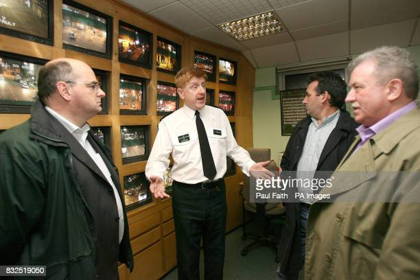 Assitant Chief Constable Duncan McCausland talks to from Belfast city councillor Pat Convery Barry Gilligand Vice Chairman of the Northern Ireland...