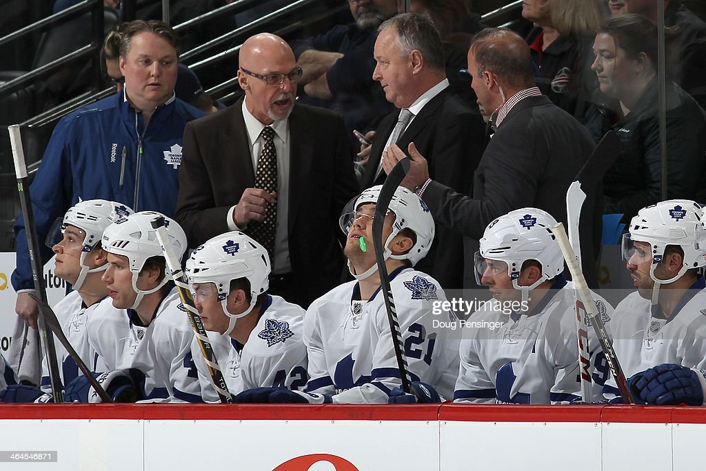 Assitant coach Dave Farrish (2L), head coach <a gi-track='captionPersonalityLinkClicked' href=/galleries/search?phrase=Randy+Carlyle+-+Ice+Hockey+Coach&family=editorial&specificpeople=679108 ng-click='$event.stopPropagation()'>Randy Carlyle</a> (C) and assistant coach Greg Cronin (R) confer on the bench as they face the Colorado Avalanche at Pepsi Center on January 21, 2014 in Denver, Colorado. The Leafs defeated the Avalanche 5-2.