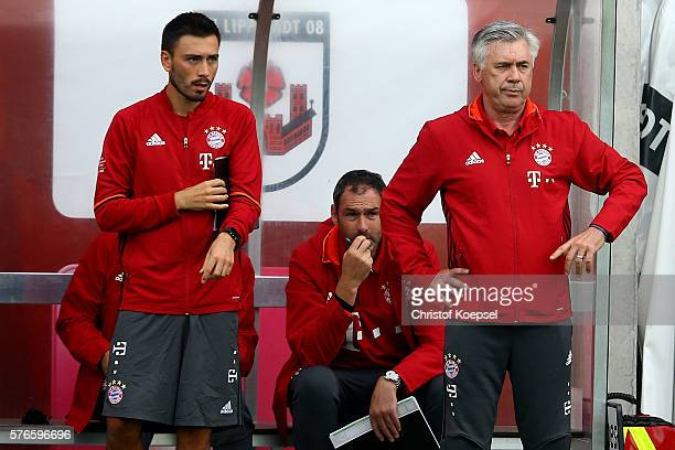 Assitant coach Davide Ancelotti and head coach Carlo Ancelotti of Bayern Muenchen stand on the bench during the friendly match between SV Lippstadt...