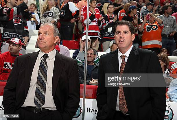 Assitant Coach Kevin McCarthy and Head Coach Peter Laviolette of the Philadelphia Flyers watch from the bench as the Flyers take the ice prior to an...