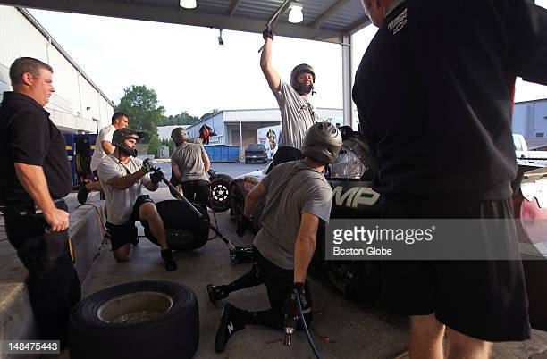 Associate 48/88 pit crew coach Lance Munksgard at far left keeps a watchful eye on pit practice Everything is timed and repeated with different...