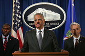 US Associate Attorney General Tony West US Attorney General Eric Holder and US Attorney for the District of Colorado John Walsh listen during a news...